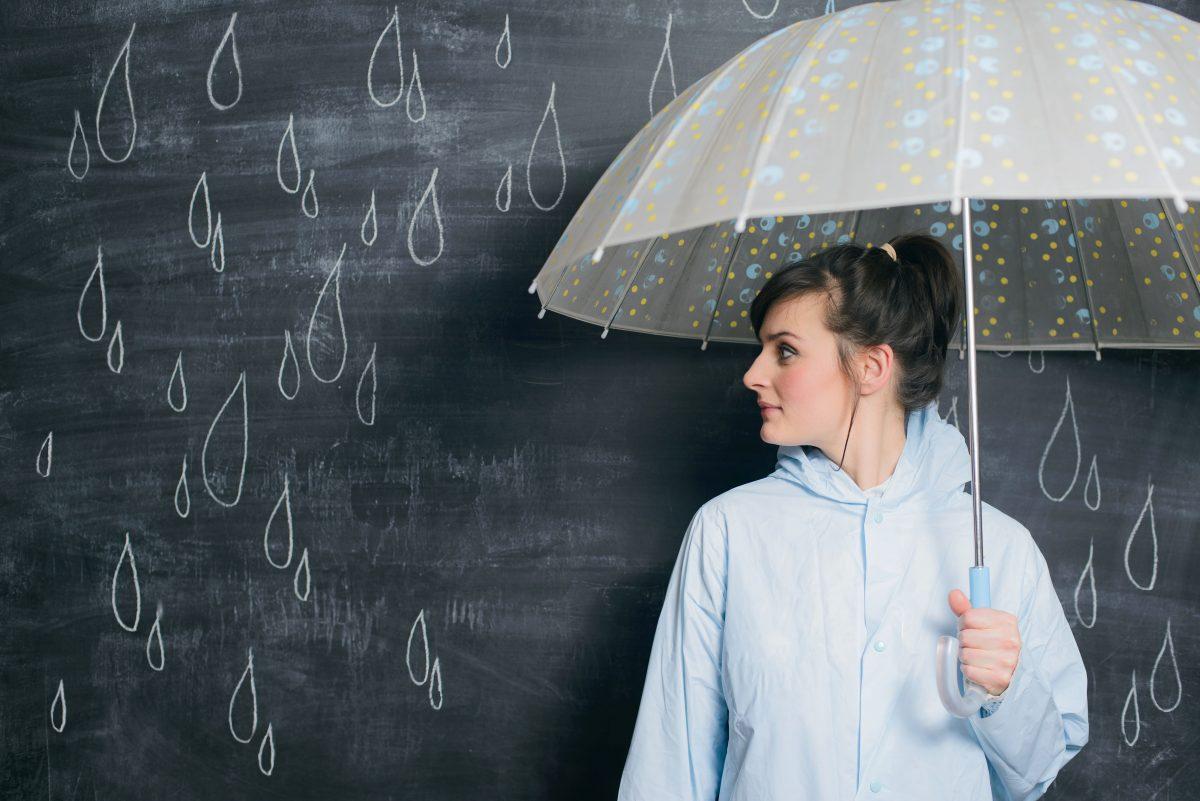 woman-under-umbrella-on-drawn-raindrops-PKJL7CP-1200x801.jpg